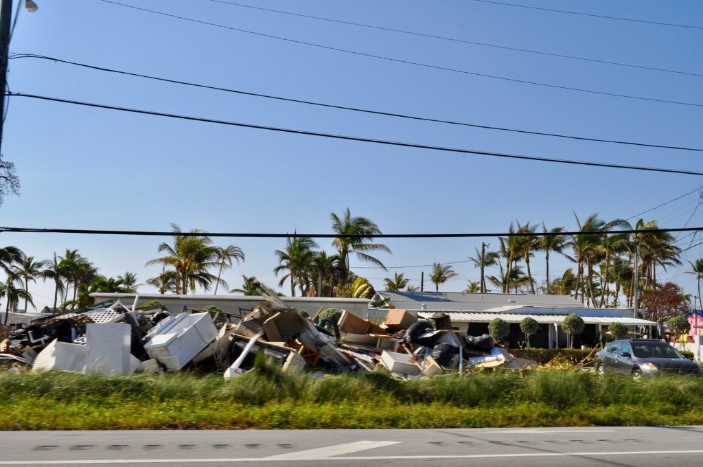 Piles of damaged property along the side of the highway after hurricane Irma.