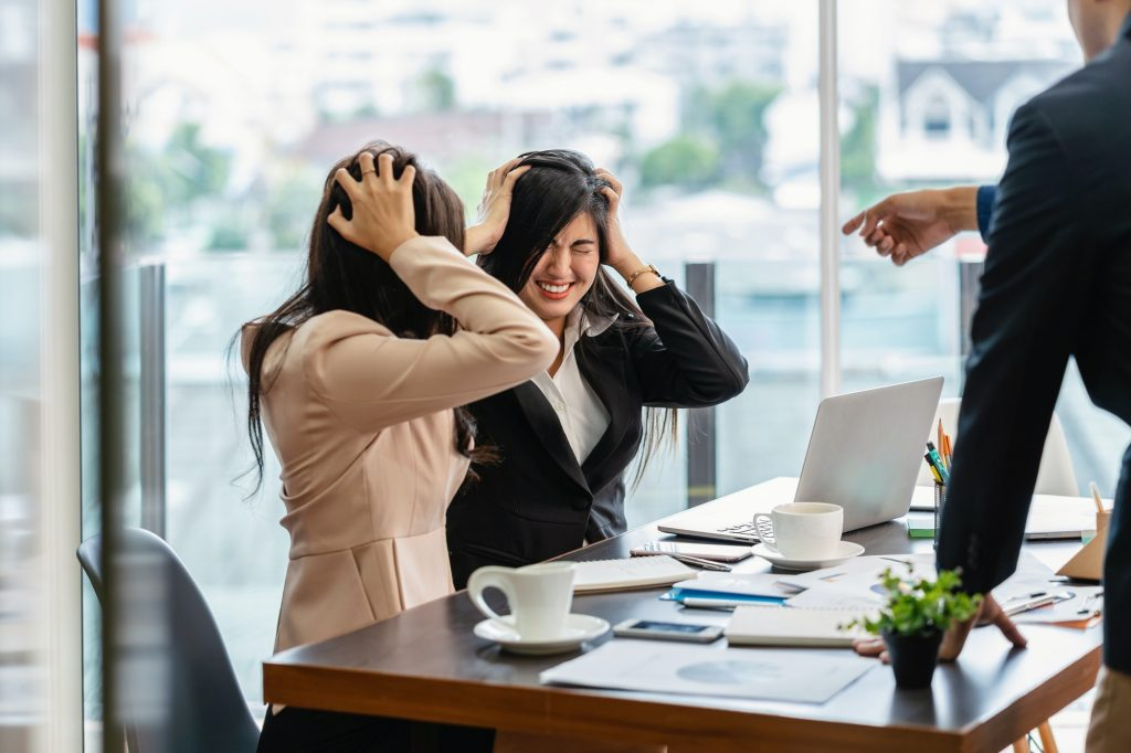 Scene of Furious boss scolding asian young couple businesswoman in formal suit